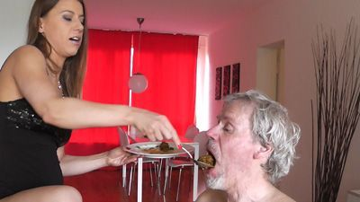 Feeding her slave with shit
